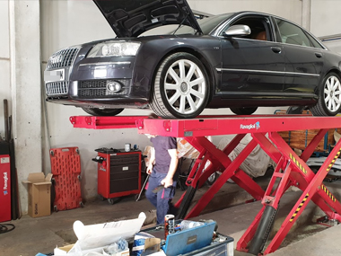 Audi S8 on ramp in workshop