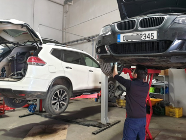 BMW 320i on workshop ramp