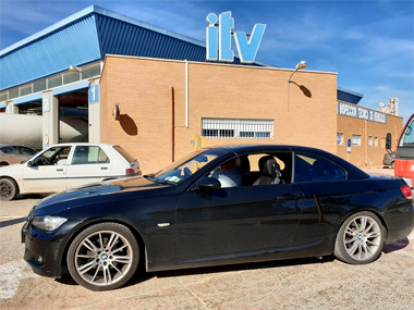 BMW 330i below ITV sign