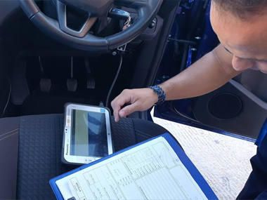 Engineer uses diagnostic equipment