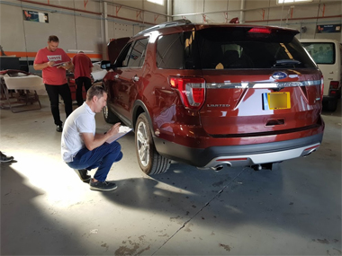 Ford Explorer with engineers