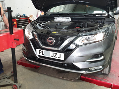 Nissan Qashqai on ramp at our workshop