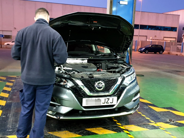 Nissan Qashqai with ITV technician