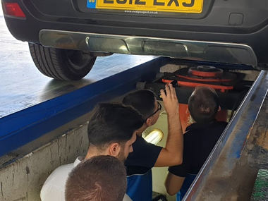 Inspectors check suspension on Peugeot 3008