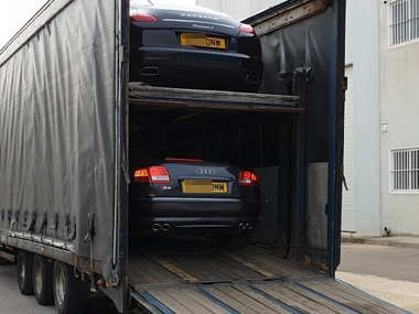 Porsche and Audi on transporter