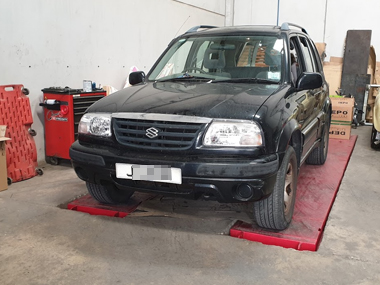 Suzuki Grand Vitara on workshop ramp