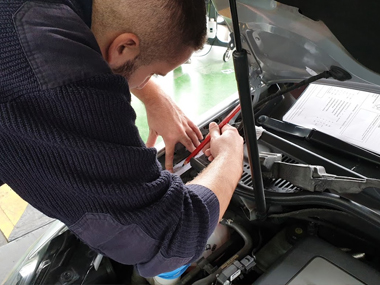 ITV technician under bonnet