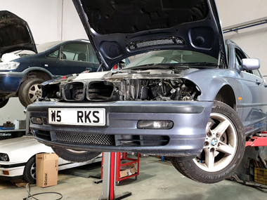 BMW 328i with headlights removed